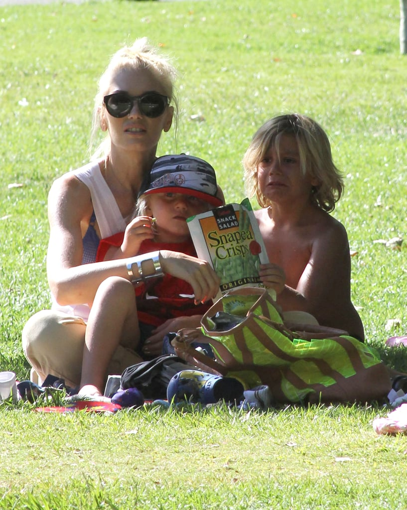 Gwen Stefani sat with her boys in the shade.