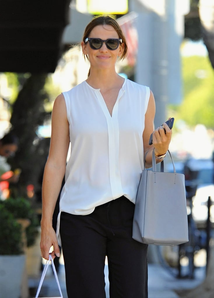 We're starting to think that Jennifer Garner is physically incapable of looking anything less than lovely. The Nine Lives actress appeared as carefree as usual as she enjoyed the sunshine during a stroll around LA on Thursday. Dressed in a breezy white top and loose-fitting black pants, Jennifer was seen taking daughters Violet, 10, and Seraphina, 7, shopping before they all headed to dinner together. This is only the latest of many gorgeous outings Jen has taken recently, from giggling with a friend on the way to the gym to breaking into a big grin amid reports she and estranged husband Ben Affleck had reconciled. If you (like us) never get sick of seeing her trademark smile, check out more photos from her afternoon below!