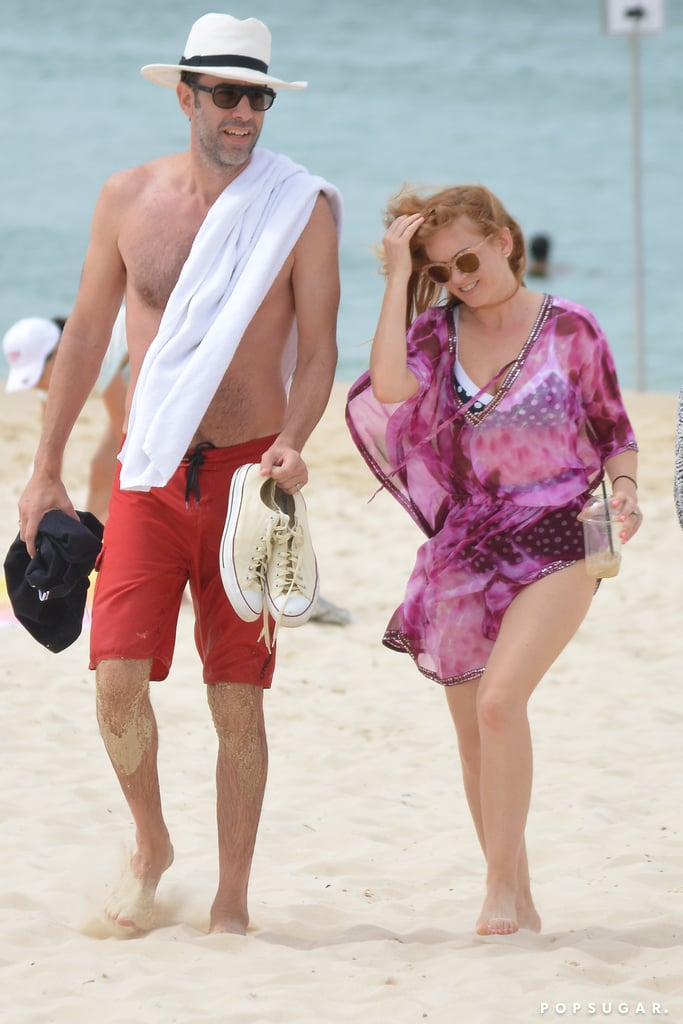 Sacha Baron Cohen and Isla Fisher hit up Bondi Beach in Australia on Tuesday. The couple, who celebrated six years of marriage this year, kicked back and relaxed on the sand and enjoyed the beautiful ocean view. Sacha went shirtless in a pair of red board shorts and at one point was spotted taking a dip in the ocean. Clad in a blue polka-dot bikini and magenta swimsuit cover-up, Isla basked in the sun and cooled herself down with an ice-cold drink. The couple's getaway is a nice break for Sacha, who is likely prepping for his upcoming role in Mandrake the Magician.       Related:                                                                                                           Isla Fisher and Sacha Baron Cohen Escape to Cannes For Some Quality R&R on a Yacht