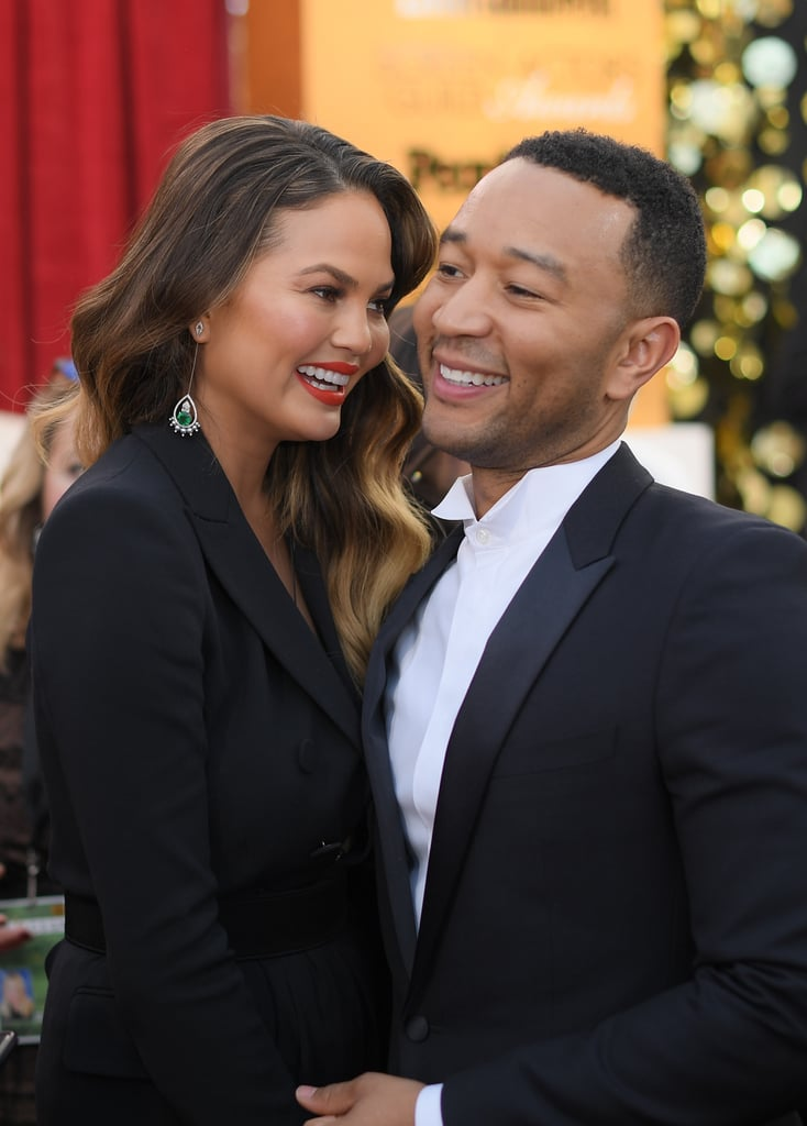 Chrissy Teigen and John Legend kicked their typical date night routine up a notch on Monday. The adorable duo stepped out for an appearance at the Screen Actors Guild Awards at LA's The Shrine Auditorium, where they lit up the red carpet with their infectious smiles. Chrissy and John, who recently had an extremely unpleasant encounter with a member of the paparazzi, seemed to be having a blast in front of the event's photographers, holding each other close and letting loose a few giggles. It's safe to say that the only way they could possibly have looked cuter is if they'd brought their incredibly sweet daughter, Luna.