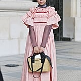"""Style with a """"more is more"""" pink and red ensemble."""