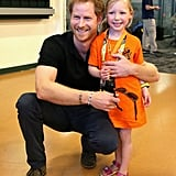 Prince Harry cuddled close to a young fan in Orlando back in May.