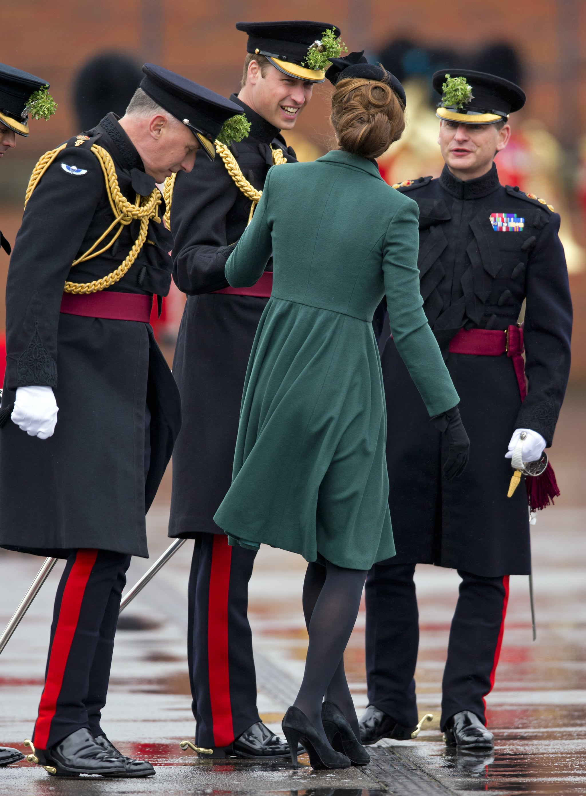William helped Kate  when her heel got stuck in a grate during a St. Patrick's Day visit to the Iris Guards in Aldershot, England, in March 2013.