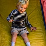 Kai Schreiber was all smiles as he went down the slide at the farmers market in Brentwood.