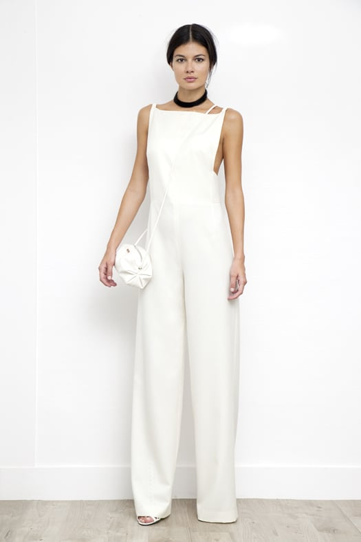 Jumpsuit With Leather Shoulder Strap in Cream Wool, Sunset Watersnake Small Cross Body Bag in Cream, Scandal Patent Sandal Bootie in Cream. Photo courtesy of Tamara Mellon