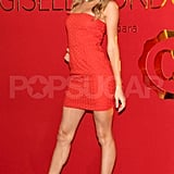 Gisele Bundchen wore a hot red dress.