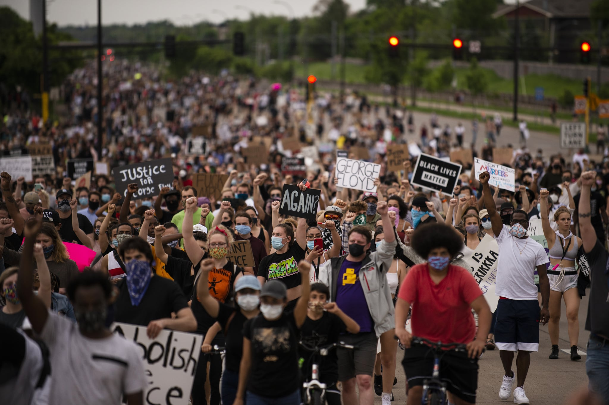 MINNEAPOLIS, MN - MAY 26: Protesters march on Hiawatha Avenue while decrying the killing of George Floyd on May 26, 2020 in Minneapolis, Minnesota. Four Minneapolis police officers have been fired after a video taken by a bystander was posted on social media showing Floyd's neck being pinned to the ground by an officer as he repeatedly said,