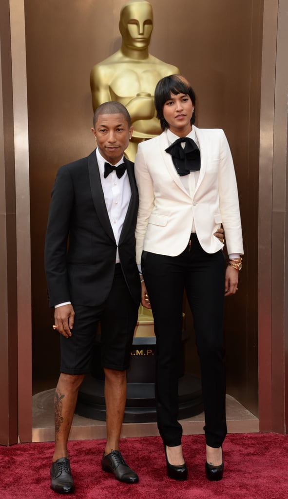 Pharrell and his wife, Helen Lasichanh, wore coordinating ensembles.