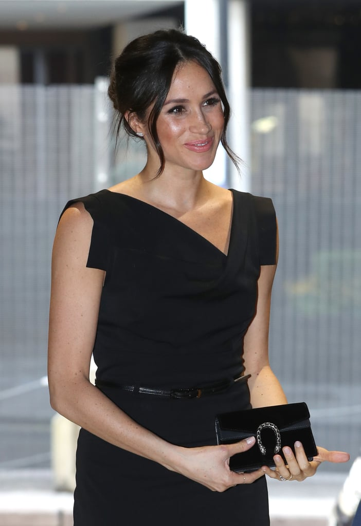 """Clearly a fan of Gucci accessories, Meghan coordinated this """"Jackie O"""" Black Halo dress with an elegant bag from the Milan based fashion house. She was attending the Women's Empowerment Reception in London in April 2018, right before her wedding."""