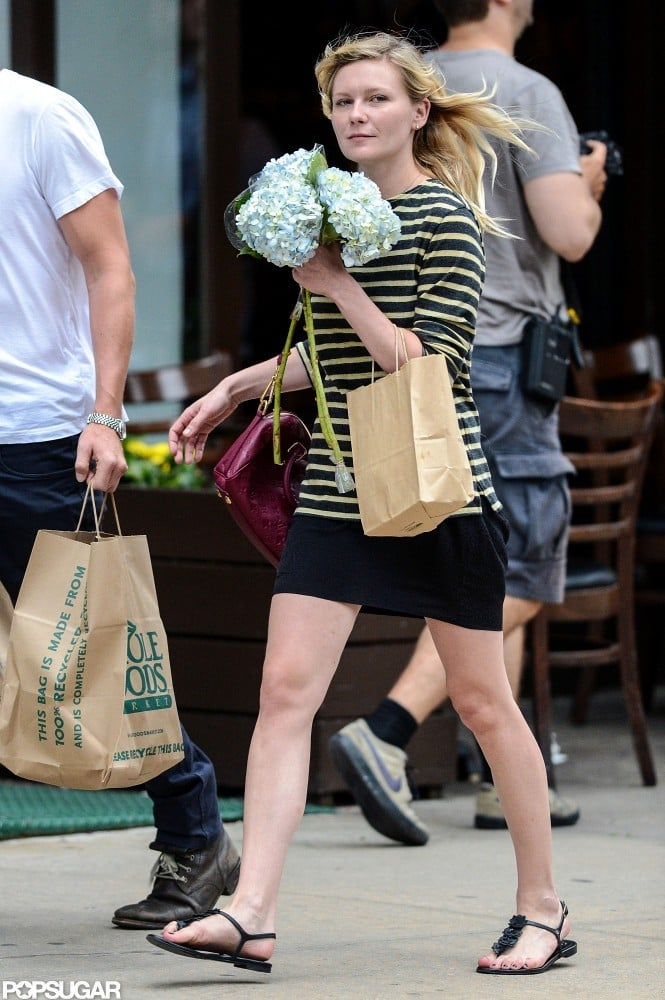 Kirsten Dunst carried flowers out of Whole Foods.