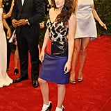 Kristen Stewart posed on the steps at the Met Gala wearing Balenciaga.