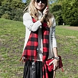 A bright red Balenciaga and a birght red scarf to match.