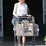 Taylor Swift Makes a Red-Lipped Grocery Stop Between Business Deals