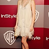 Emma Roberts looked cute and girly in this neutral ruffled number.