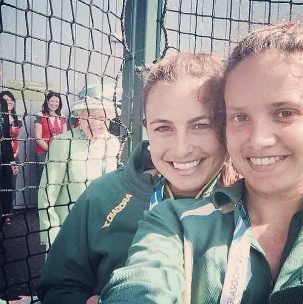 Queen Elizabeth II kicked off the royal photobomb craze when she popped up in the background while two Australian athletes were taking selfies together at the Commonwealth Games. Source: Instagram user jaydetaylor