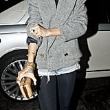 Business on top, party on the bottom. For a 2012 evening out in London Rihanna layered up in a tweed jacket, black turtleneck, denim shorts, and thick tights.
