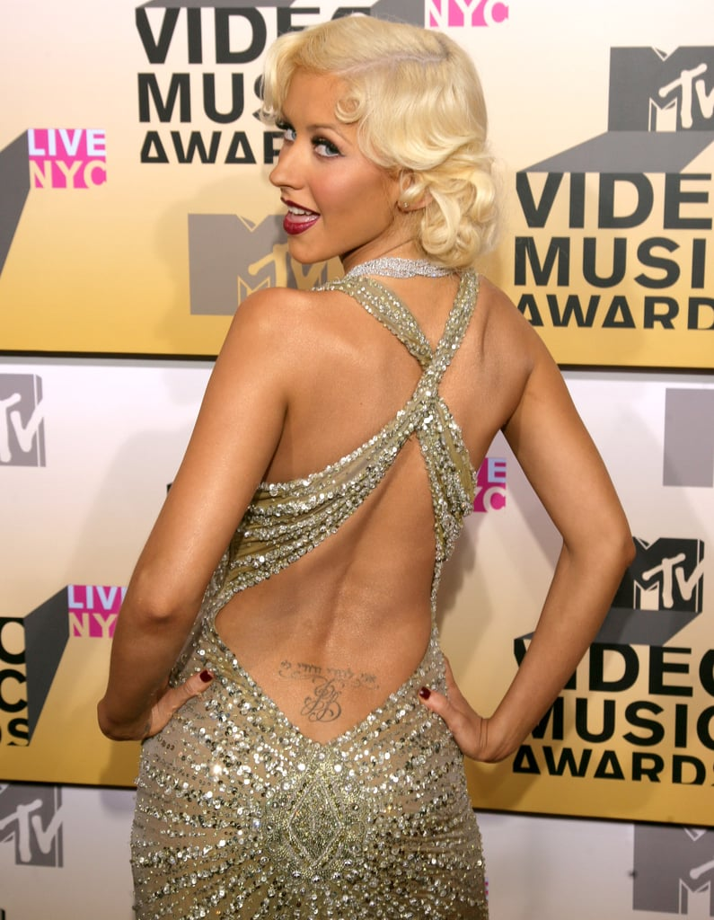 """Christina is another celebrity with an ex's initial's permanently marked on her body. Her lower-back tattoo reads """"I am my beloved's and my beloved is mine"""" in Hebrew, right above her ex-husband's initials, JB."""