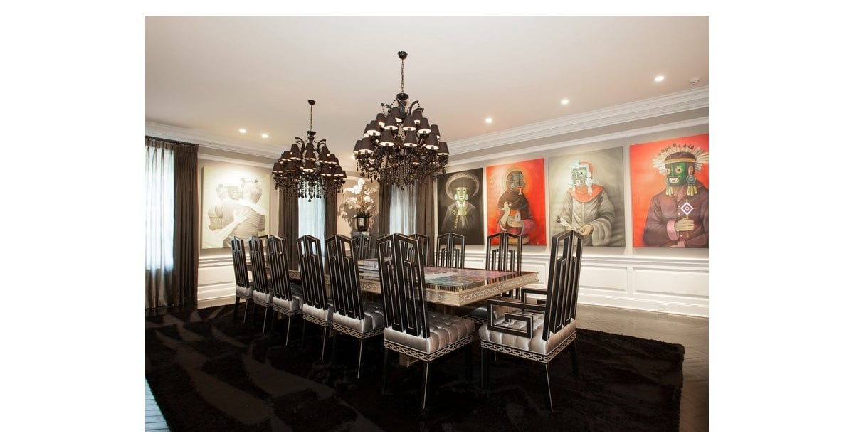 Large Paintings And Dark Decor Give The Dining Room A