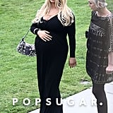 Pregnant Jessica Simpson wore a long black dress to an April 2013 wedding ceremony in Pacific Palisades, CA.