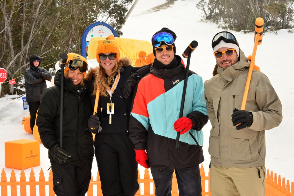 What a crowd! Lara Bingle, Laura Csortan, Hayden Quinn and Chris Joannou partied in the snow at a Veuve Clicquot party on Aug. 2.