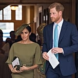 The Duchess styled her dress with a thin belt, Stephen Jones hat, clutch, and gloves, all of which perfectly matched the olive green hue.