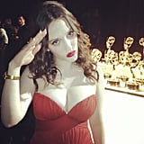 Kat Dennings saluted the camera by the Emmy statuettes backstage. Source: Instagram user hellogiggles