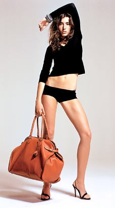 Super Sized Handbags and Back Pain