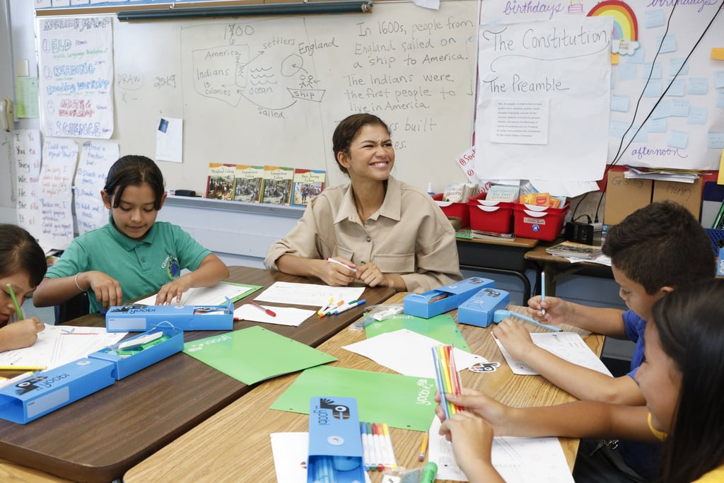 """Zendaya is paying it forward in her hometown of Oakland, CA! On Sept. 19, the 23-year-old actress teamed up with school supply store Yoobi to announce the company's donation to 450 students at Global Family Elementary School. She made a surprise appearance at the school to share the news before stopping by a fifth-grade classroom to hand-deliver pencil cases filled with crayons, markers, pencils, glue sticks, and more. She even stuck around to chat and color with some of the kids.  The Euphoria star was also awarded the Yoobi Changemaker Award for her efforts to support Oakland schools and communities. """"Thank you @yoobi for helping me surprise every student at a very special school in my hometown of Oakland with school supplies to start the school year off right!"""" she captioned an Instagram snap. Keep scrolling to see more fun photos from her visit! Related: Look Back on Zendaya's Evolution From Disney Star to Hollywood Icon"""