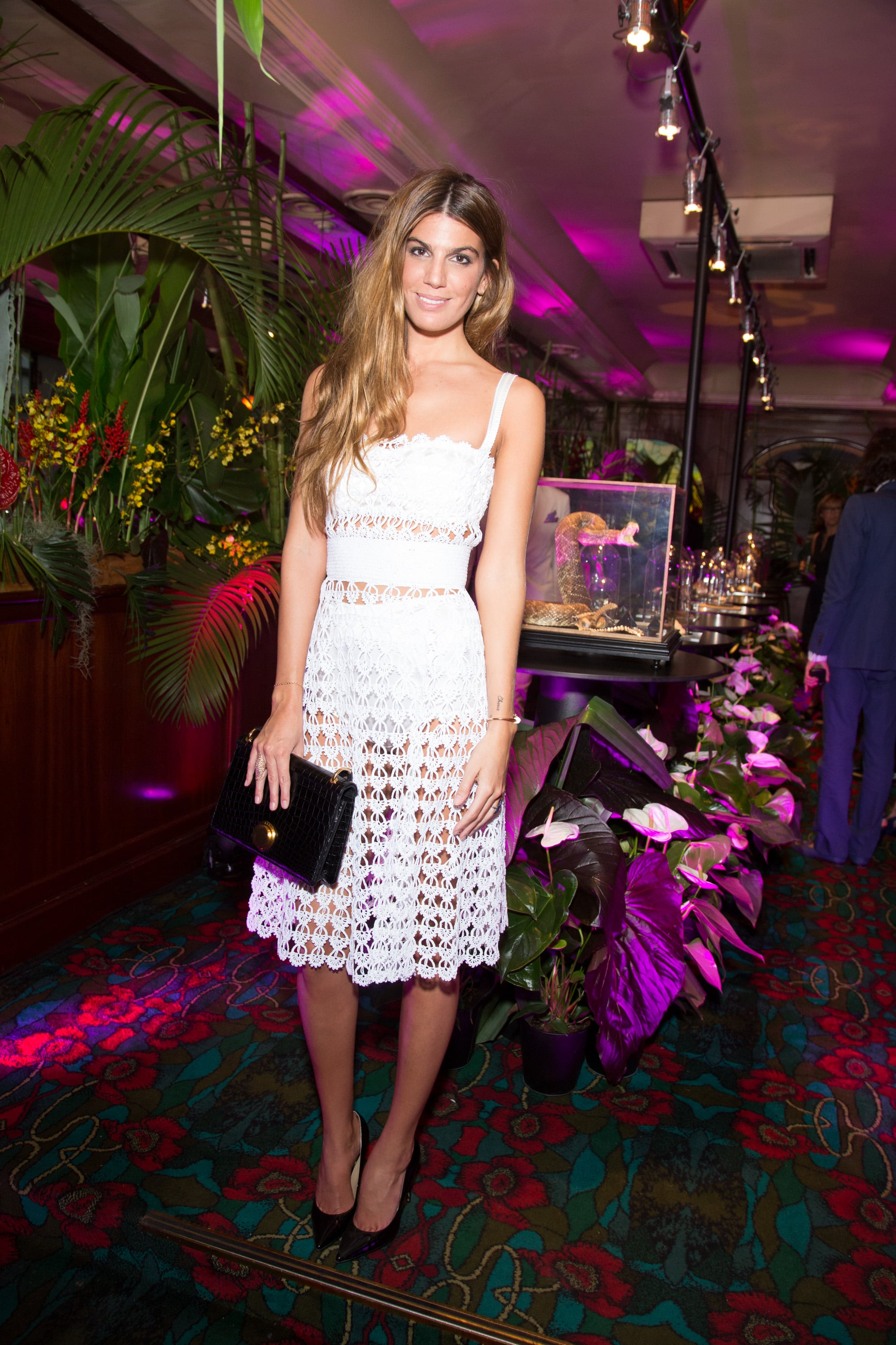Bianca Brandolini played peek-a-boo in white at the Paris launch of Eugenie Niarchos's jewelry line.