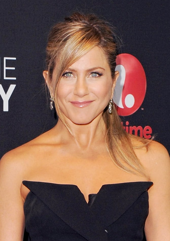 Let your side bangs hang loose à la Jennifer Aniston. Get her Call Me Crazy: A Five Film premiere look by making a diagonal part on one side to separate bangs.