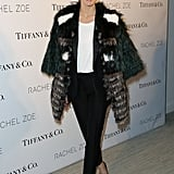 At an event in March in NYC, Olivia stayed warm and stylish in a multi-colored furry topper and classic black pants.
