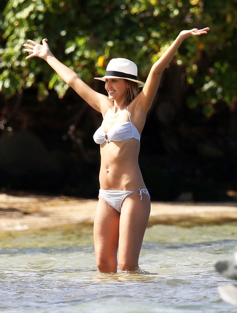Jessica Alba is no stranger to the two-piece and looks equally as fantastic in a swimsuit on screen as she does while lounging on the beach. The actress even rocked a bikini just four months after giving birth to her daughter Honor in 2008, and continued to flaunt her tan and toned body after having daughter Haven in 2011. Plus, she shows off plenty of PDA with husband Cash Warren on their many trips to St. Barts and Hawaii — we're not sure if their kisses or her many scorching bikini moments are hotter! Let's pay homage to Jessica Alba's insane bikini body.      Related:                                                                                                           The Ultimate Celebrity Bikini Gallery