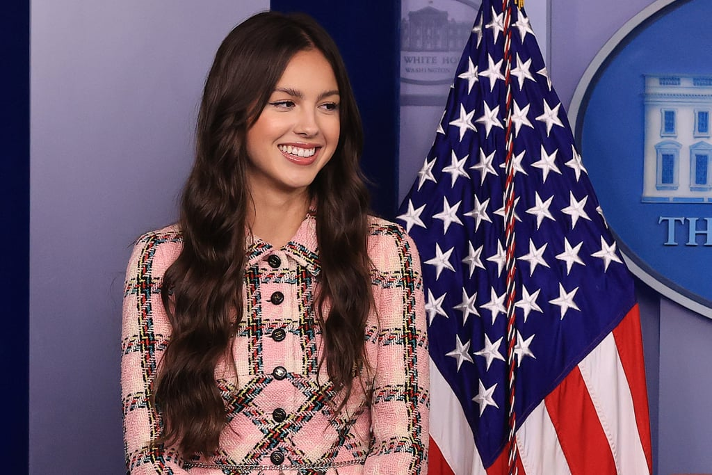 """Olivia Rodrigo is using her platform for good. On Wednesday, the """"Drivers License"""" singer made a trip to the White House to encourage people to get the COVID-19 vaccine. Seemingly channeling her inner Elle Woods, Olivia wore a pink plaid dress suit and white platform high heels as she made her way inside for the important visit. Reporters also shared a few snapshots of Olivia getting the grand tour of the White House as she visited the West Wing.  During a press conference, Olivia noted that she was """"beyond honored and humbled"""" to """"help spread the message about the importance of youth vaccination."""" """"I'm in awe of the work President Biden and Dr. Fauci have done and was happy to help lend my support to this important initiative,"""" she said. """"It's important to have conversations with friends and family members, encouraging all communities to get vaccinated and actually get to a vaccination site, which you can do more easily than ever before given how many sites we have and how easy it is to find them at vaccines.gov."""" Olivia is also set to meet with President Joe Biden and Dr. Anthony Fauci and will record a handful of videos encouraging her followers to get vaccinated as well as answer a few questions. Olivia and President Biden teased her visit on Instagram on Tuesday when the president shared a throwback photo of him, writing, """"I know this young person would've gotten vaccinated, but we've got to get other young people protected as well. Who's willing to help?"""" Olivia eventually chimed in, writing, """"i'm in! see you tomorrow at the white house!"""" See more pictures from her White House visit ahead.       Related:                                                                                                           Which Song From Olivia Rodrigo's Sour Album Are You, Based on Your Zodiac Sign?"""