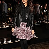 Shay Mitchell attended the DKNY show in a black leather jacket, black blouse, black tights, and black pumps, then injected major flair thanks to a printed circle skirt.