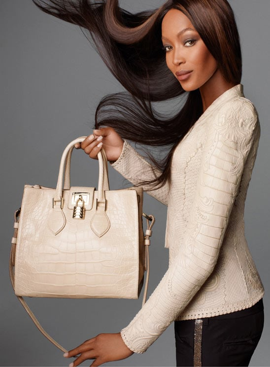 Supermodel Naomi Campbell shows of croc-print tote from Roberto Cavalli's Spring '12 line. Source: Fashion Gone Rogue