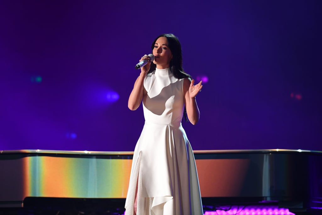 "Kacey Musgraves lit up the Grammys stage in more ways than one on Sunday night. During the show, the country music singer put her gorgeous vocals on display as she crooned her ballad ""Rainbow"" from her Grammy-nominated album Golden Hour. As if her beautiful lyrics about holding on to hope even the darkest times wasn't enough to make you tear up, we really lost it when the stage lights turned into an actual rainbow behind her. Don't mind us, we'll just be sobbing over this performance for the rest of the night."