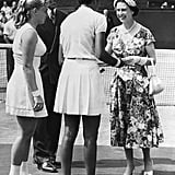 Queen Elizabeth II presents the Wimbledon trophy to Althea Gibson in 1957