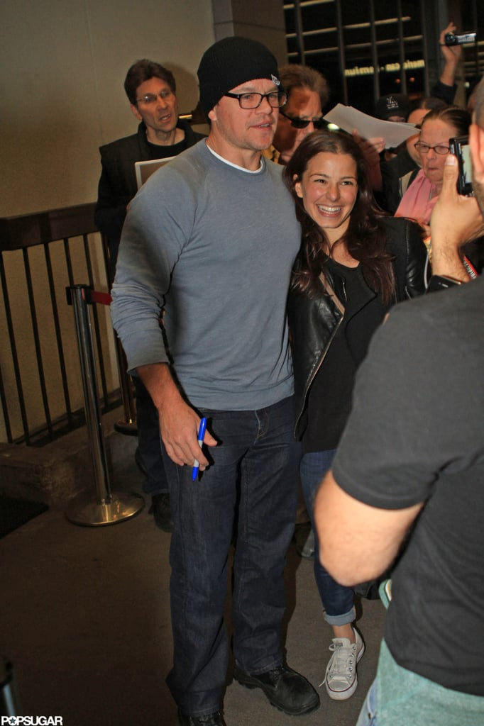 Matt Damon posed for photos with fans at the airport in LA.