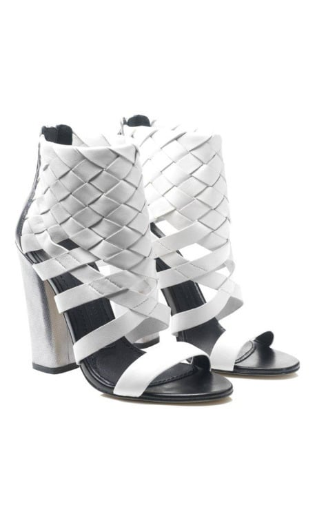 """>> For Resort 2012, Camilla Skovgaard isn't leaving her trademark serrated sole behind — it shows up on stiletto sandals and wedge booties alike. But she does add a new element — plaiting — by adding woven leather detailing to chunky-heeled sandal boots (left) and those aforementioned stilettos. The whole collection, in the slideshow, <product target=""""_blank"""" href=""""http://modaoperandi.com/catalog/camilla-skovgaard-resort/looks/"""">is now available for pre-order on Moda Operandi</product>."""