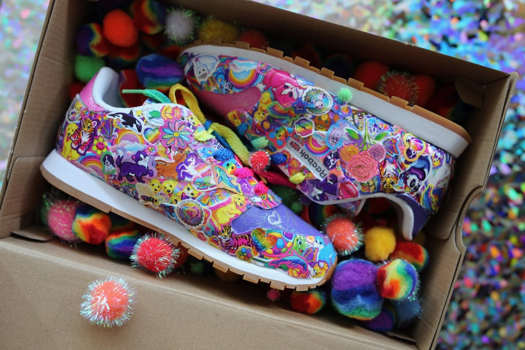 We may have (begrudgingly) ditched our rainbow-covered Trapper Keeper folder long ago, but we're sure as heck not ready to say goodbye to Lisa Frank's nostalgic vibes just yet. That's why our hearts practically leaped for joy when we heard from Nylon that Lisa Frank herself teamed up with Reebok to custom design two one-of-a-kind pairs of multicolored sneakers, just in time for back-to-school season.   The bright, quirky kicks are completely covered — and when I say covered, I mean it — in our favourite Lisa Frank characters, including Panda Painter and Forrest, the rainbow-coloured tiger. All of these designs are splashed on top of Reebok's Classic Leather shoe and finished off with rainbow shoelaces — because duh. Fourth-grade me would've busted open my piggy bank and snatched these babies up in a heartbeat, and honestly, 23-year-old me is still pretty freakin' into them. Before you grab your credit card to place an online order, we must clue you into the slight downside of this exciting news: these custom kicks will only be given to two (very lucky) winners via a social media giveaway. *Cue the single tear rolling down my face.* If you're interested in adding these sneakers to your closet, you must tweet @ReebokClassic and @LisaFrank to answer the following question: what's your favourite trend from your back-to-school days?  Excuse us while we tweet our answer 17 times per day in hopes of snagging these beauties, which you can scope out in the nostalgia-packed pictures ahead.