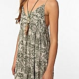 We'd wear this printed babydoll with ankle wrap flats and a floppy hat.  Insight Vintage Motif Dress ($78)