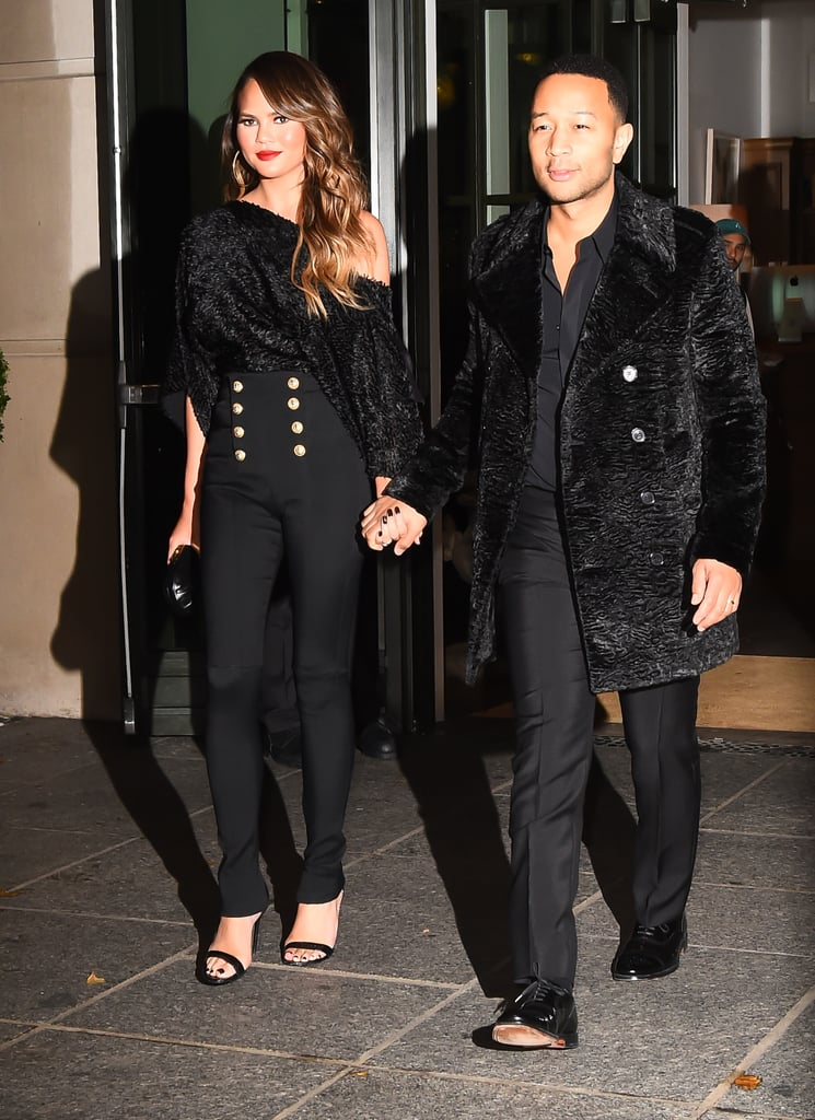Chrissy Teigen stepped out hand in hand with John Legend wearing a one-shoulder furry textured top to match John's coat.