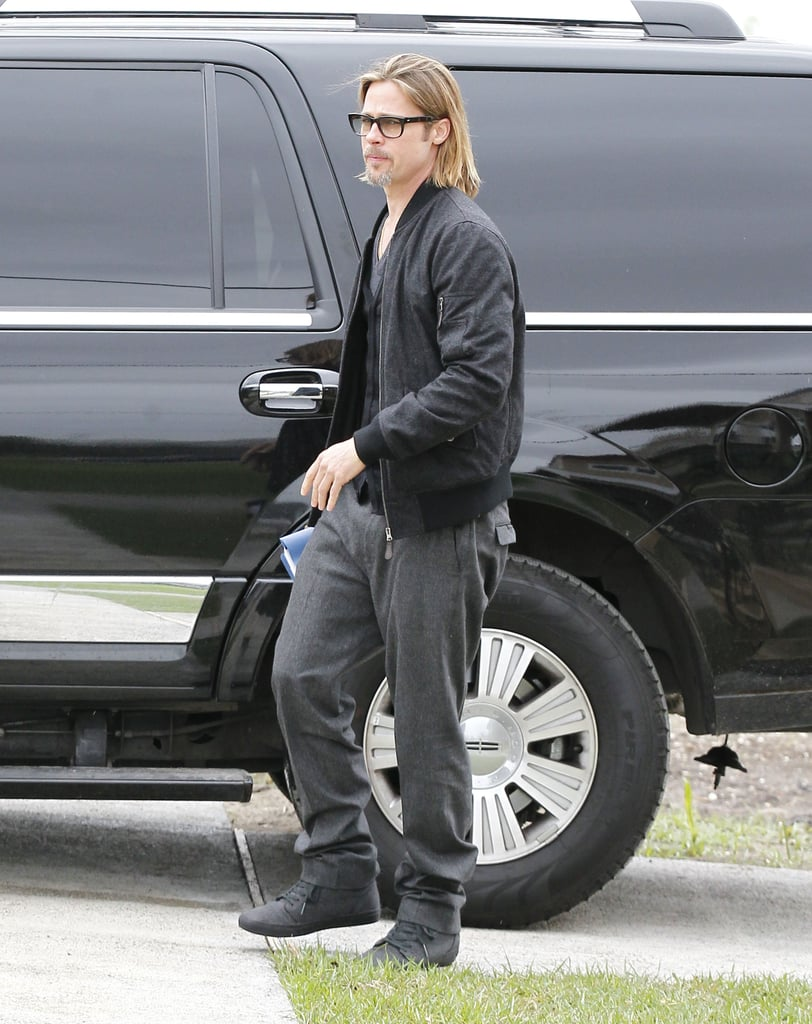 Brad Pitt arrived solo without an entourage to tour houses built by his Make It Right Foundation.