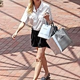 Diane Kruger shopped in Beverly Hills wearing a black and white ensemble: a short-sleeved button-down, black shorts, and leopard loafers.