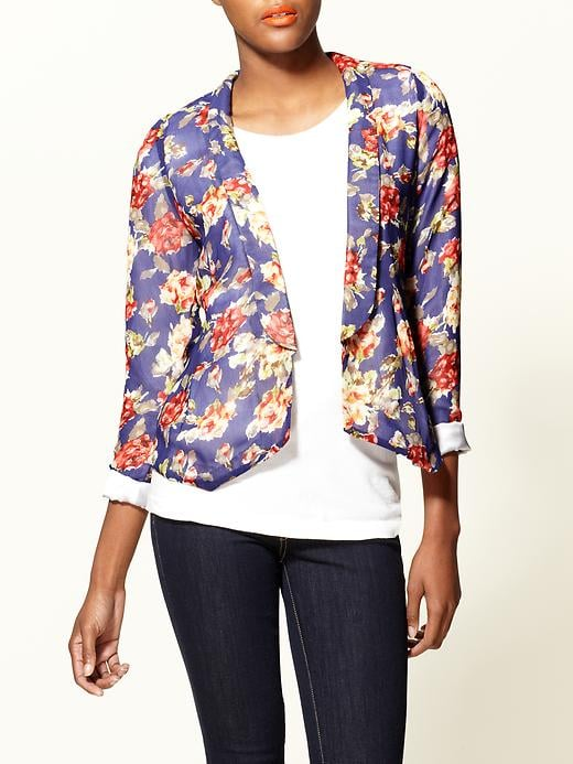 Embrace the floral trend and top your favorite work trousers with this pretty blazer.  Pim + Larkin Floral Blazer ($50)