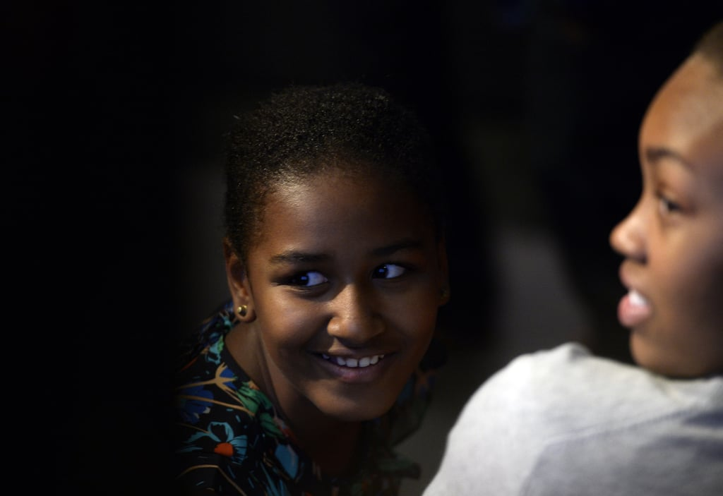 Sasha Obama smiled from the audience while First Lady Michelle Obama spoke with students in Johannesburg in June 2013.