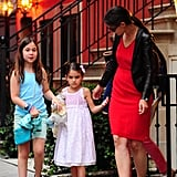 Katie Holmes, Suri Cruise, and a little friend had afternoon tea in NYC.