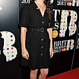 Lana Del Rey was demure in a black dress with gold buttons and black pointy Jimmy Choo kitten heels.