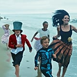 Angelina and her kids ran on the beach during their 2015 Vogue photo shoot.