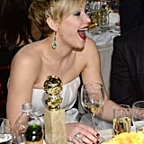 Jennifer Lawrence laughed while inadvertently posing with her Golden Globe. Source: Christopher Polk/NBC/NBCU Photo Bank/NBC